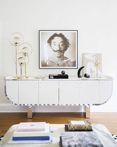 A 1980s mirror-trimmed console is topped with a vintage lamp