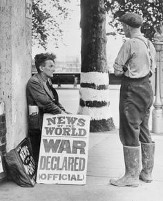 A newspaper seller on the Embankment in London. 1939