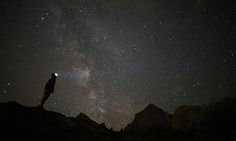 <strong>Crissolo, Italy<br></strong>A photographer prepares to take pictures of the annual Perseid meteor shower in the Monviso Alps.