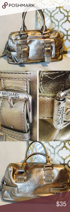 MICHAEL KORS GOLD HANDBAG  Michael KORS HANDBAG in a good condition litter stains in the hardware shown in the pic  inside and out nice bag  % leather Michael Kors Bags