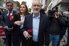 Best photos of the day: a dirty rotten job and a Tory poster