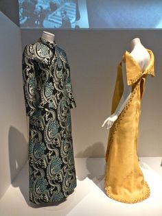 Wool brocade coat made for Maria Callas by Biki in 1971 on left and yellow winged evening dress by Federico Forquet circa 1966 at the V&A Mu...