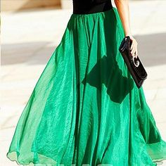 We do LOVE this emerald color floor-length skirt.