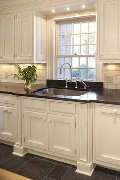 I like the three small lights above the sink/window...also similar look to what our kitchen will be like!