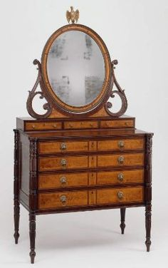 "1809 American (Massachusetts) Dressing table with looking glass at the Museum of Fine Arts, Boston - From the curators' comments: ""In the late eighteenth century, independent dressing glasses commonly were placed on tables or chests of drawers. The practice led to the evolution of a new form in bedroom furniture-the bureau with an attached mirror."""