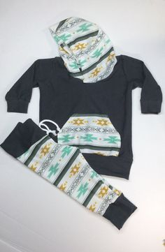 Baby boy or toddler Aztec sweat outfit. Hoodie and sweats are Lycra knit, it makes for a comfortable fit. Light weight knit sizes 0-3 to 3T Choose between gold top or dark grey top sweat pants or choose both With would make a great baby shower gift. Dont see your size message me for sizes you need