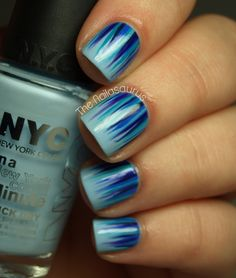 Light blue base, different colors of blue striped on with nail striper from cuticle towards tip. The Nailasaurus: Blue Waterfall Nail Art