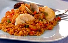Catalan-Style Monkfish paella: Hailing from Catalonia, this paella features monkfish, which has gained in popularity in recent years. Prepared and cooked correctly, monkfish tastes like lobster. Here, the subtle flavor and tenderness of the monkfish add the perfect accents to the plump, juicy rice. A chilled white wine is the perfect accompaniment to this seafood paella