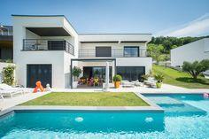 L'agence 3C a choisi de conserver un esprit cubique pour agencer l'extérieur de cette maison contemporaine.
