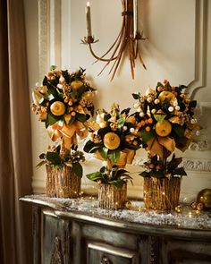 """Golden Topiaries. Twig containers, Artificial fruits, berries and greenery. 16"""" H x 10"""" W, $67.50. 20"""" H x 11"""" W, $81.00. 24"""" H x 13"""" W, $108.75. Horchow.com 10/16/14"""