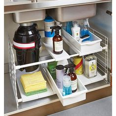 An under-the-sink organizer that makes storing cleaning supplies a breeze. | 23 Things That Will Make Your Tiny Kitchen Seem Bigger