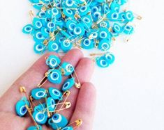 Evil eye safety pins | Etsy AU Eye Safety, Safety Pins, Evil Eye, Eyes, Floral, Handmade, Hand Made, Florals, Craft