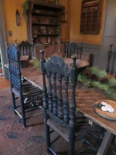 Colonial Kitchen With Farmhouse Table and Black Chairs