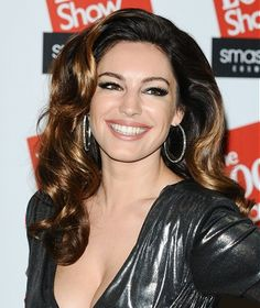 We all love the lovely Kelly Brook and her vintage glamour look!  She makes getting dressed up look easy.  Her beautiful healthy hair enriched with the warm tones that run through it. Long brown voluminous hair style #ukhairdressers  loads of ideas - VISIT  www.ukhairdressers.com