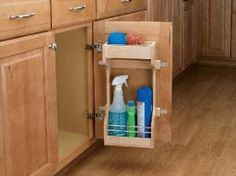 """13-1/2 inch Wood Door Storage Organizer. The sink base door storage organizer is a handy unit that stores cleaning supplies on the door of your under sink cabinet. Scrubbing tools and scouring pads store neatly away in one handy compartment. The upper shelf holds your small scrubbers and the tray insert is removable for easy cleanup! Wood Classic Sink Base Door Storage Organizer designed for 36"""" Sink Base Cabinets."""
