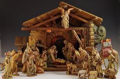 "A stunning ANRI hand-carved nativity creche set, with lighted nativity and working music box which plays ""Silent Night"" and ""Adeste Fideles."" Purchased by the current owners..."