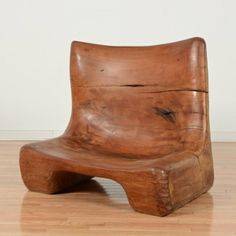 """South American modernist wood studio chair, Circa 1970s, Argentine or Brazilian, butterfly joints at back, unsigned, 27.5""""h x 32""""w x 23""""d Provenance: Property removed from """"Neumann House"""" by Marcel Breuer, NY"""