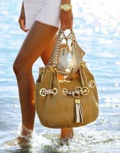 looks extra wonderful walking in the water...Michael Kors