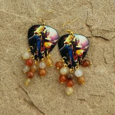 Led Zeppelin guitar pick earrings with multicolored natural stones.