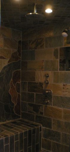 Lovin' the dark tile and the bench in the shower.