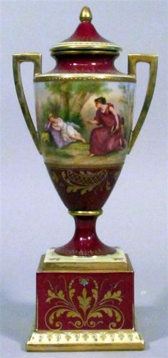 Royal Vienna Porcelain Handled Urn  Cover, Baluster Urn Painted to Show Classical Figures in a Wooded Landscape on a Ruby Ground, Raised in Square Pedestal Base. circa 1875-1900
