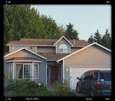 Finished!lt brown roof with Sherwin Williams  colors: Earl grey for the house body and Snowbound for the trim.