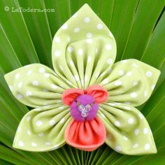 Tutorial for DIY Cymbidium orchid fabric flowers. Pattern shows how to recreate these beauties in fabric for wedding flowers, fabric flower headbands, brooches, etc. Ribbon Embroidery Tutorial, Fabric Flower Tutorial, Silk Ribbon Embroidery, Embroidery Kits, Embroidery Designs, Bow Tutorial, Fabric Flower Headbands, Fabric Flower Brooch, Fabric Flowers