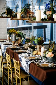Hanging wedding decor in shades of blue, brown, and gold