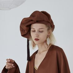 Composition and Care MaterialWhite: PolyesterBrown: Rayon, CottonBlack: Tencel, Spandex Beret, Winter Hats, Berets