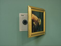 Party decoration idea: Consider getting a hidden safe like this... or hang a picture of a safe front on the wall behind a painting