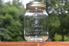 Personalized mason jars!  Such a great idea instead of toasting glasses.  Also super cute for a unity sand ceremony or as bridesmaids/groomsmen gifts.  From Gatlinburg's Little Log Wedding Chapel at www.logchapel.com