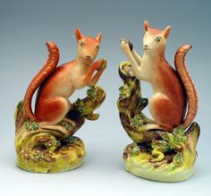 Pair Staffordshire pottery figures of Squirrels eating nuts. c1850