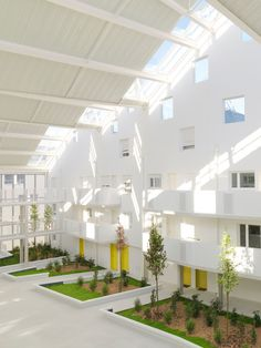 An old submarine base in Bordeaux provided the site for this docklands housing complex by Agence Nicolas Michelin & Associés, where homes and gardens are arranged on either side of a glazed atrium Industrial Architecture, Residential Architecture, Amazing Architecture, Landscape Architecture, Interior Architecture, Co Housing, Social Housing, Bordeaux, Atrium Garden