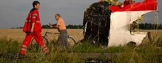 A paramedic at the crash site of Malaysia Airlines Flight 17 near the village of Hrabove, eastern Ukraine, on July 19 (Vadim Ghirda/AP) Kerry: Russian missile took down MH17 The secretary of state says U.S. intercepted talk of transfer of missile system to separatists.