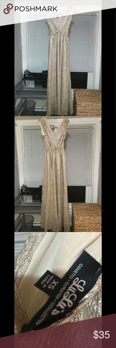 Lulu 's ALL THAT SHIMMERS IS GOLD LIGHT GOLD MAXI Extra small, worn once, no signs of wear. I'm 5'4 and wore it with heels and it was just right. I have an ivory/gold beaded belt from Etsy that I wore with it. You can have that too if you want, just let me know.  https://www.lulus.com/products/all-that-shimmers-is-gold-light-gold-maxi-dress/65786.html Lulu's Dresses Prom