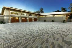 The clean lines of Plank pavers from Tremron give your home a modern and sophisticated appeal. Permeable Driveway, Driveway Landscaping, Driveways, Thai House, Hardscape Design, Brick Pavers, Tuscan House, Backyard Patio, Patio Decks
