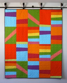 http://www.amyalamode.com/blog/my-quilts/  Great idea for a new baby--or someone who needs a dash of cheer--