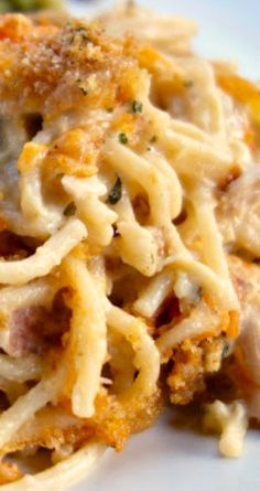 Cheesy Chicken Spaghetti Casserole ~ Chicken, spaghetti, cream of chicken soup, sour cream, butter, seasonings, Parmesan and cheddar cheese... THE BEST!