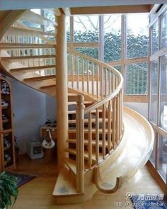 Spiral staircase with a slide.