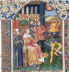 (A jester in front of a King and Courtiers in a manuscript from the 1400's. He has the donkey eared hood, common in central Europe, with a pointed hood that is common in the western end of Central Europe and that is unusual in that it has a bird's head on it. His scepter has the head that resembles himself called a Marotte.) https://mikespassingthoughts.files.wordpress.com/2013/02/court-jester-3.jpg