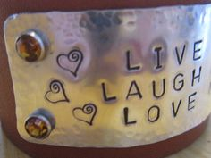 Live Love Laugh Leather and Metal Stamped Bracelet. $18.00, via Etsy.