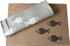 Loads of Fishes - plywood placemats and a linen tea-towel with fish figures.