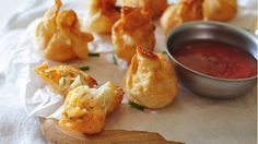 Blissful bursts of sriracha-spiced cream cheese stuffed inside wonton wrappers and fried to glory be.