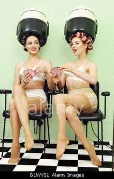 Two women in vintage hair salon playing cards. Next Salon at 310-392-6645 at 2400 Main Street in Santa Monica, CA 90405 thinks this retro picture is very cool. http://www.nextsalon.com/