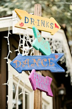 whimsical wedding signs // photo by Brooke Beasley // view more: http://ruffledblog.com/backyard-carnival-themed-wedding
