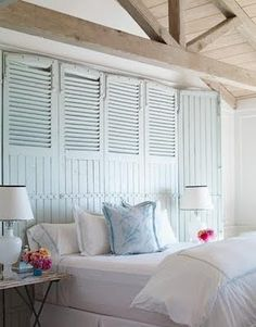 Much better than a head board and even shabby shutters add great character once painted. Another great opportunity for a perfectly validated accent colour