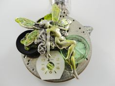 Steampunk Pin Brooch Green Absinthe Fairy with Green LED in Old Vacuum Tube in Silver by Dr Brassy Steampunk. $40.00, via Etsy.