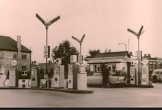 Petrol station at corner of Bounces Rd. - note that they used to sell fuel from several different companies at this time c.1960 - there are Shell, BP, Ace(?) and one other