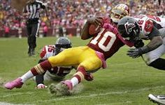 Sean Weatherspoon, right, lays out RG3, 10, who would suffer a concussion