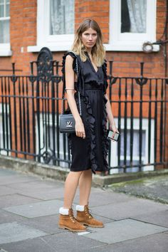 Veronika Heilbrunner rocks the Twist bag in Epi Noir at #LFW - Photograph by Diego Zuko for HarpersBAZAAR.com